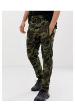 Le Breve - Schmal geschnittene Jogginghose mit Military-Muster - Grün(88936868)